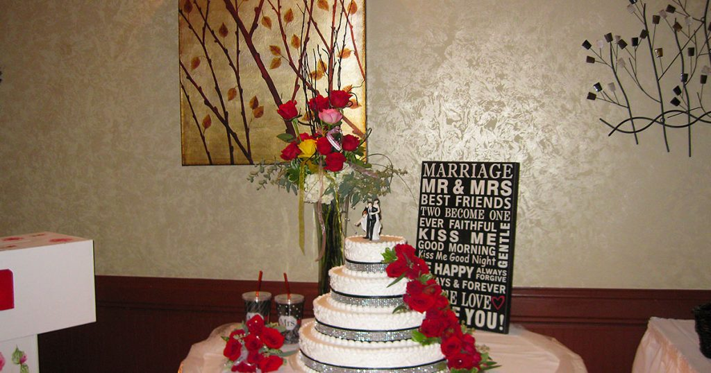 Wedding reception cake and gift table.