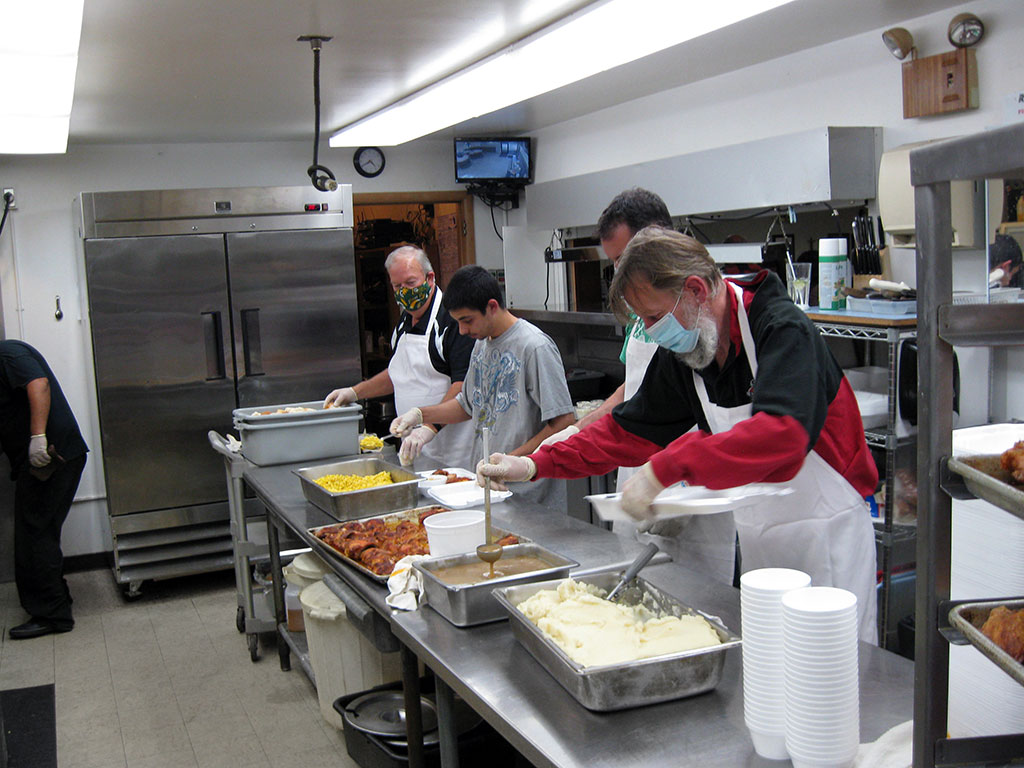 Knights of Columbus preparing food at the 10th annual chicken dinner.